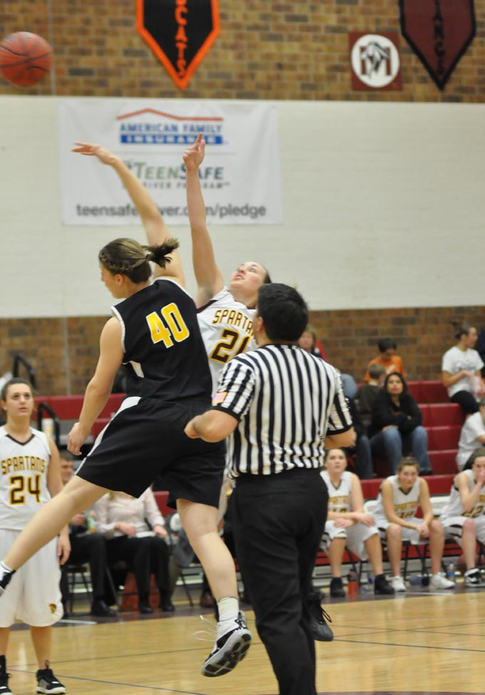2673 61 jordan sibrel controls the tip off for the eagles Spartan Girls lose to Thompson Valley
