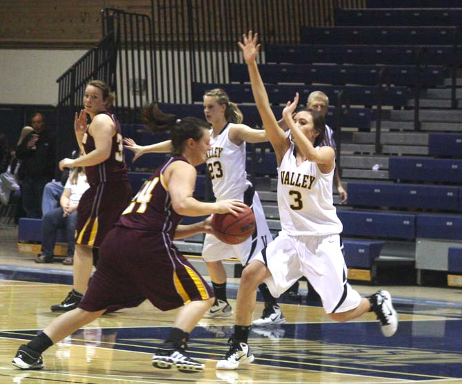 Danielle Wikre takes the ball around Valley\'s Courtney Chacon in the 2nd period.