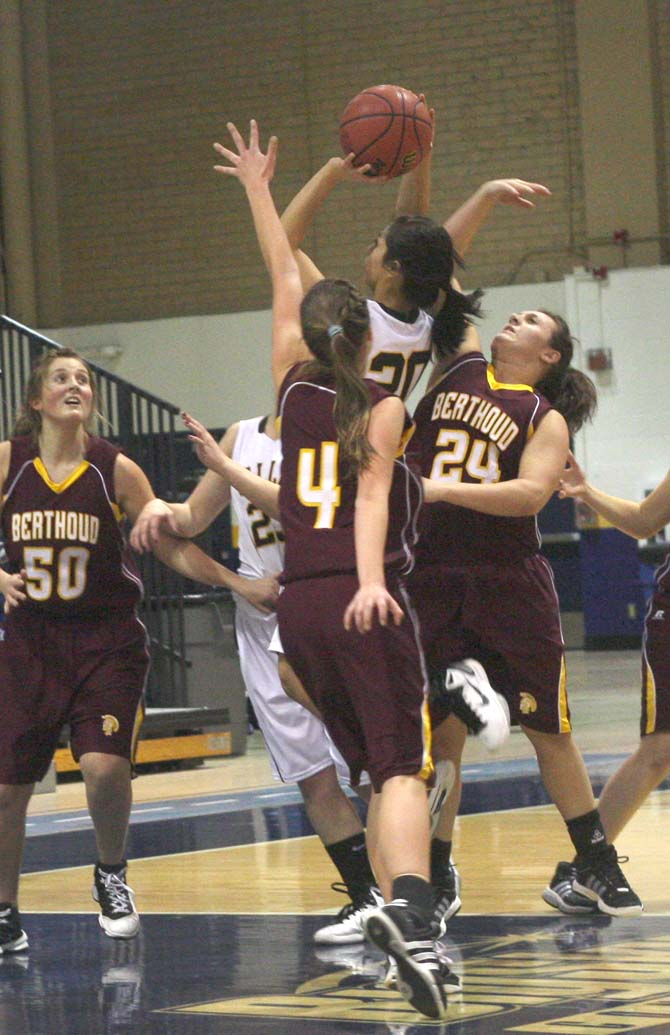 Danielle Wikre and Dillon Fagler attempt to block a shot by Valley\'s Meagan Garcia in the 2nd.