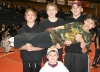 fourth-grader-joseph-colton-gets-a-lift-from-elijah-preston-and-tylor-chad-ellis-kneeling