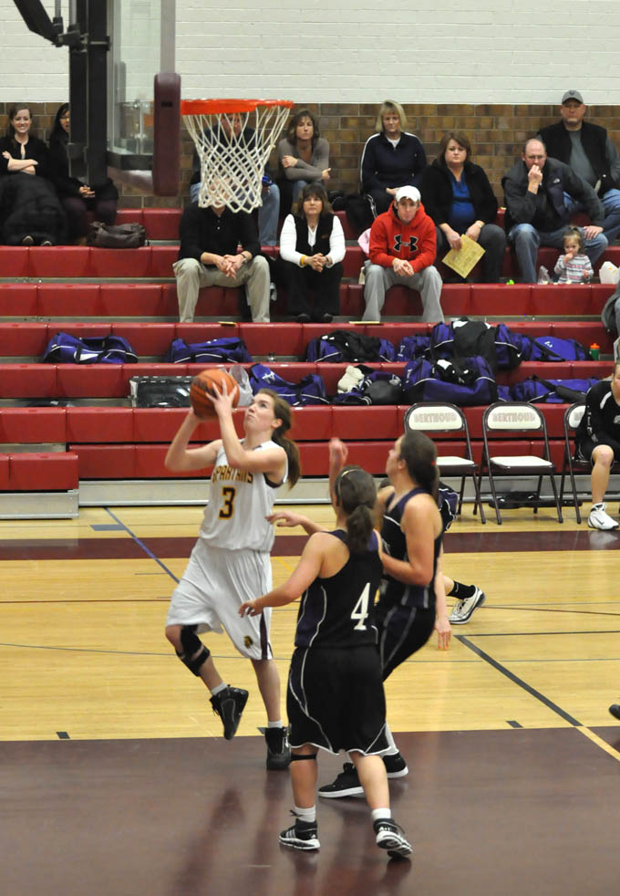 GBB Megan McGinn goes up or a shot in the first Quarter.1 Lady Spartans win in closing seconds
