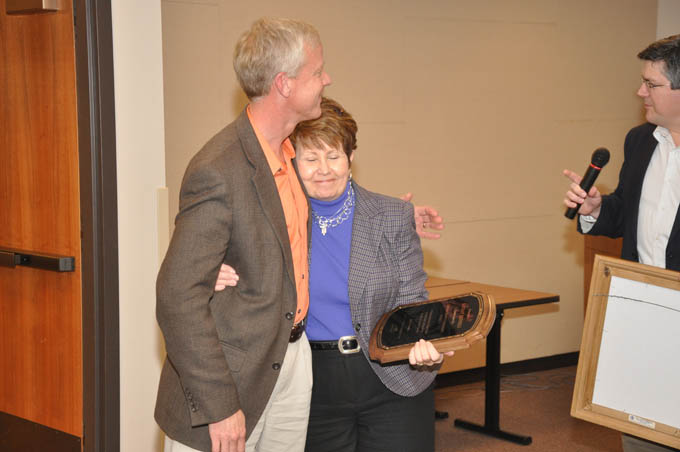 Rennels hugs Johnson Reception honoring Kathay Rennels