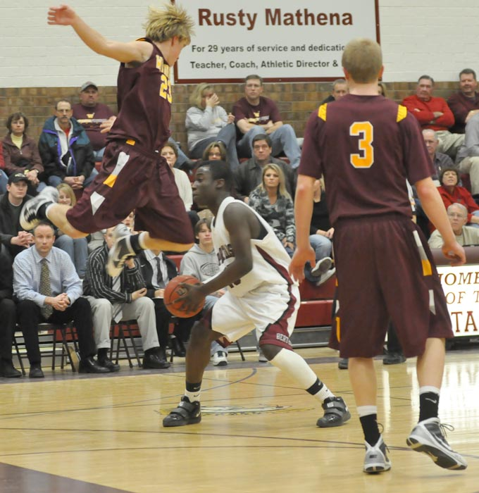 Windsors Aaron Schmidt jumps high defending against Mark Mathiesen in final minute Wizards defeat Spartan hoopsters 80 69