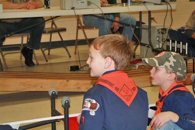 2768 Ty Rotar and Joe Malinowski watch the race Cub Scout Racers