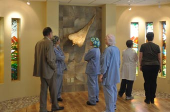 staff admiring prayer McKee Medical Center dedicates new Chapel