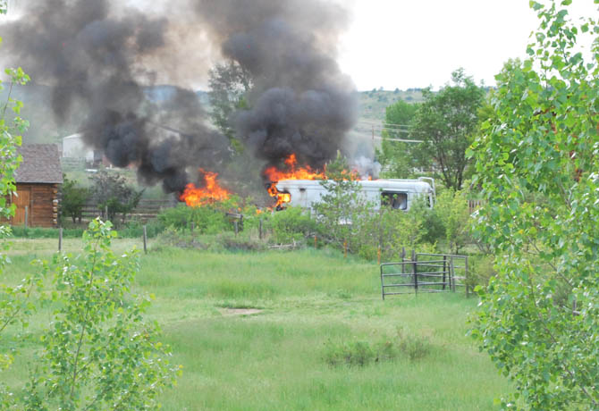 fire 2 RV fire endangers house in Blue Mountain