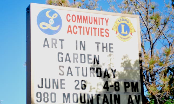 Art in the garden lions sign Berthoud Art in the Garden on June 26