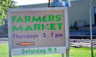 Farmers Market sign Farmers Market opens today