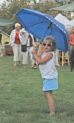 girl with umbrella Berthoud Art in the Garden a smashing success