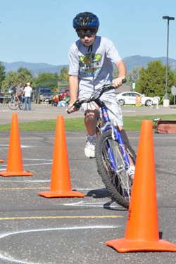 Josh barryman on the obstical cours Mayor to hand out Bike Rodeo Trophies