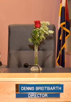 Rose for Dennis250 School Board honors Breitbarths service to community