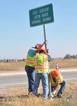 "Installing the sign250 ""Staff Sergeant Justin Bauer Memorial Highway"""