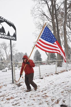Bob Talley Berthoud Veterans place flags at cemetery