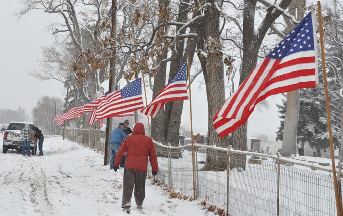 Flags in progress1 Berthoud Veterans place flags at cemetery