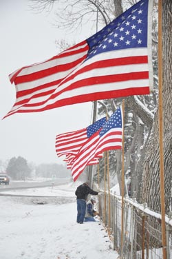 Flags waving1 Berthoud Veterans place flags at cemetery