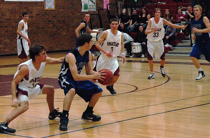 Spartan Defense1 14 11 Berthoud Boys Basketball Tops Lyons