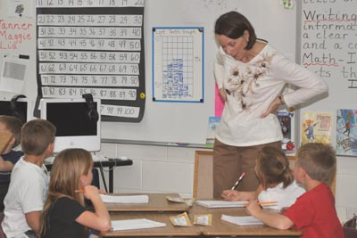 King in class room 400 Three teachers retiring at Ivy