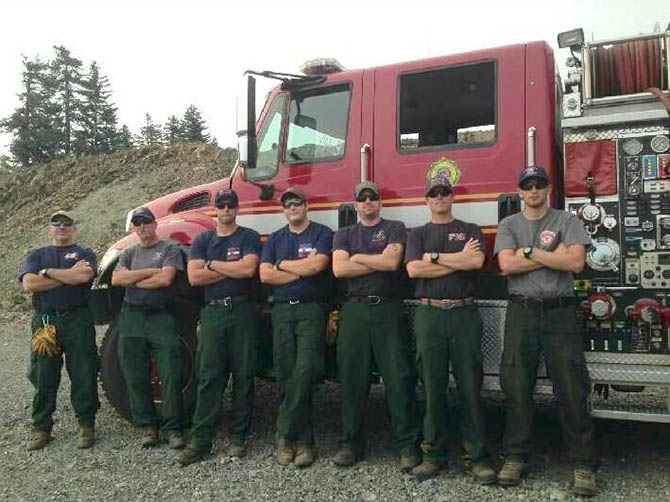 From left to right are BFPD's Engine Boss Jerry Fletcher, Colorado State Engine Boss Michael DiCristina, BFPD Fire Fighter's Jim Thompson, Ryan Nelson, Engine Operator Shane Prim, Engine Operator Jesse Treat and State Fire Fighter Michael Manzo.